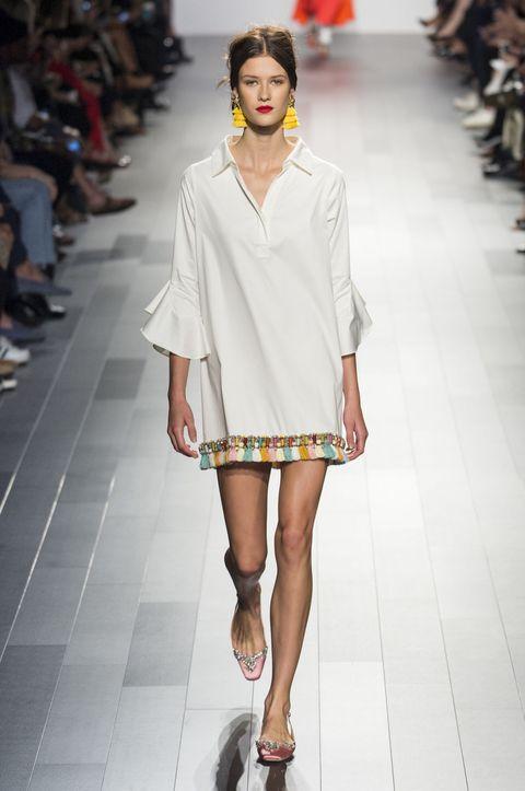 Fashion model, Fashion, Fashion show, Runway, White, Clothing, Shoulder, Footwear, Street fashion, Sandal,