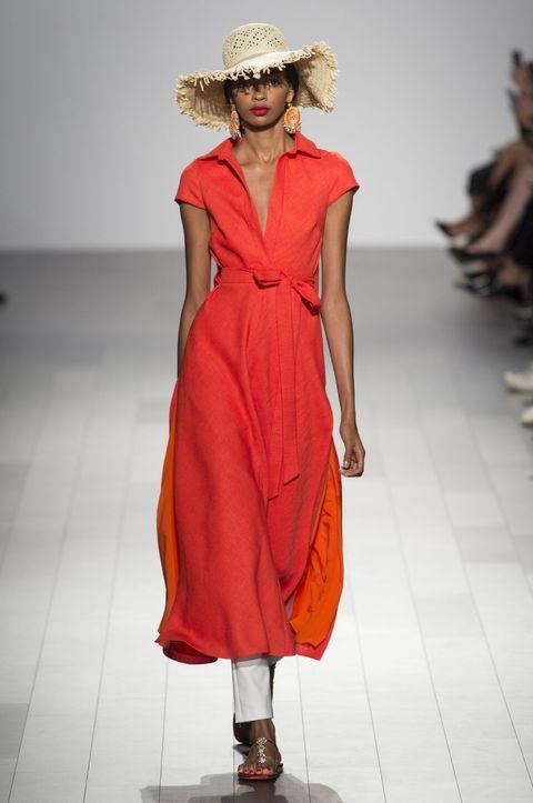Fashion model, Fashion show, Runway, Fashion, Clothing, Dress, Shoulder, Orange, Day dress, Fashion design,