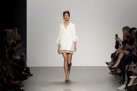 Fashion model, Fashion show, Runway, Fashion, Clothing, Shoulder, Fashion design, Dress, Model, Long hair,