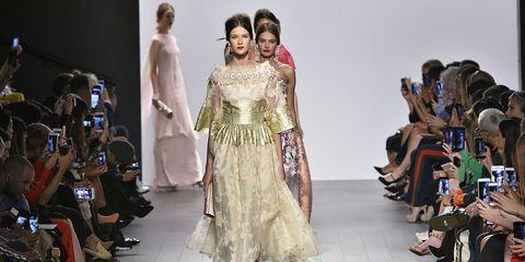 Fashion model, Fashion, Fashion show, Runway, Clothing, Fashion design, Dress, Beauty, Haute couture, Shoulder,