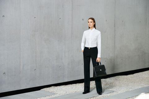 White, Street fashion, Standing, Fashion, Shoulder, Suit, Jeans, Shirt, Neck, Dress shirt,