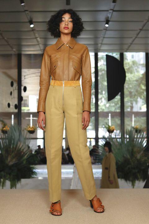 Fashion model, Clothing, Fashion show, Fashion, Runway, Brown, Waist, Beige, Yellow, Pantsuit,
