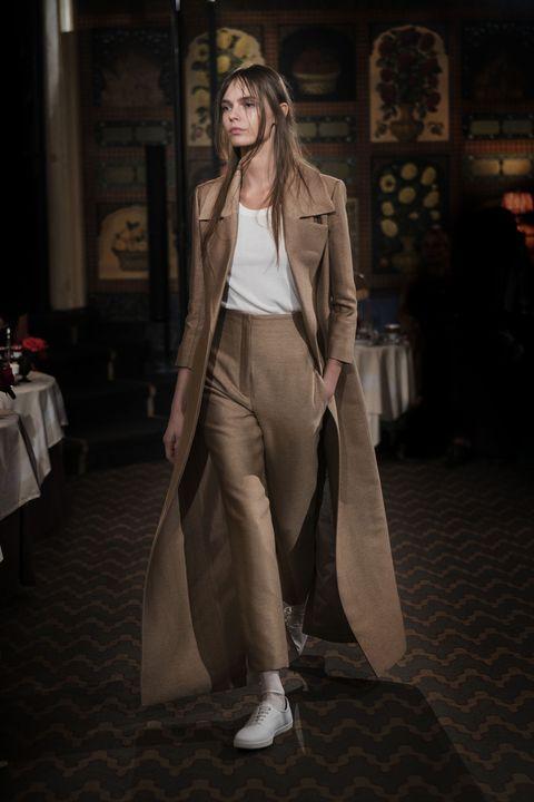 Clothing, Fashion model, Fashion, Outerwear, Fashion design, Street fashion, Trench coat, Dress, Coat, Photography,