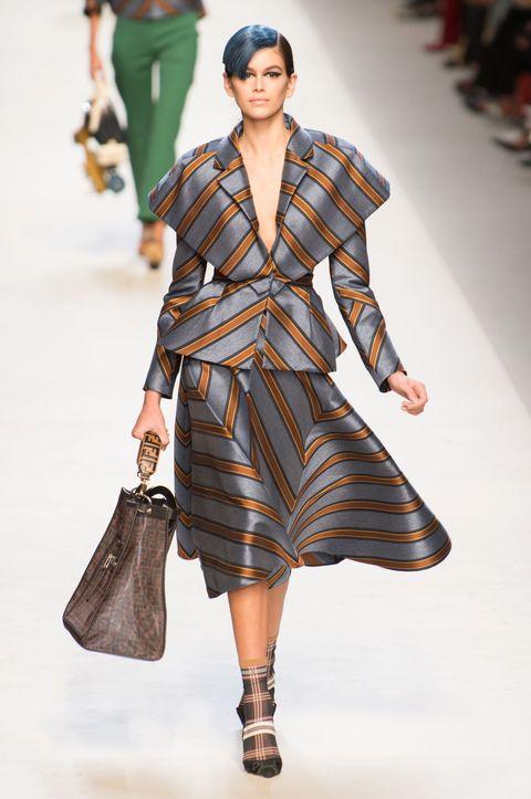 Fashion model, Fashion, Fashion show, Runway, Clothing, Shoulder, Public event, Haute couture, Outerwear, Human,