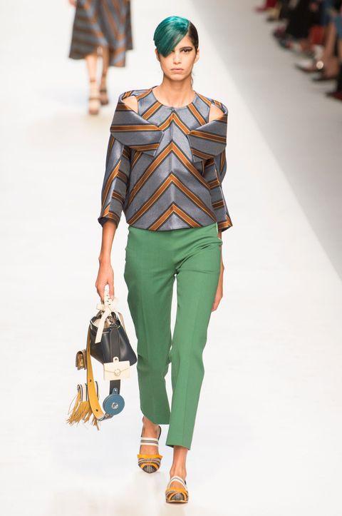 Fashion model, Fashion show, Fashion, Clothing, Runway, Green, Shoulder, Waist, Jeans, Human,
