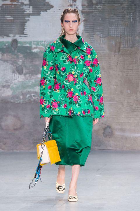 Fashion model, Fashion show, Fashion, Runway, Clothing, Green, Shoulder, Outerwear, Street fashion, Joint,
