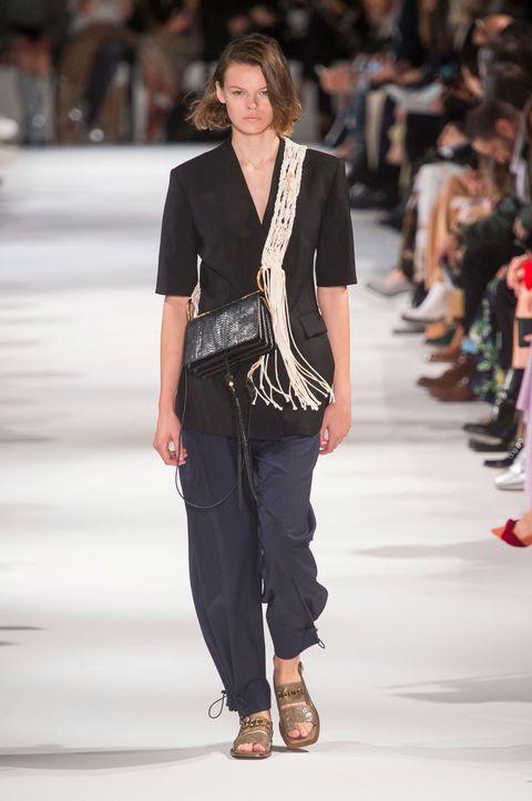 Fashion model, Fashion show, Fashion, Clothing, Runway, Outerwear, Blazer, Footwear, Waist, Human,