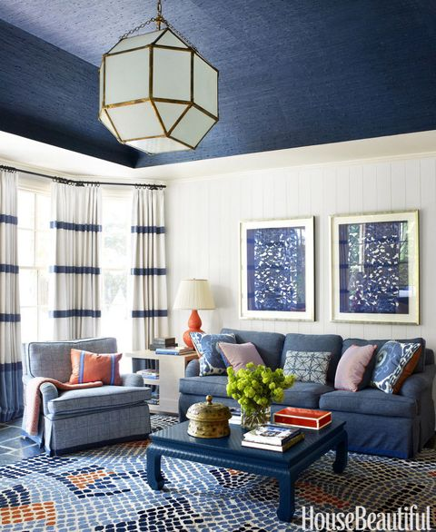 Because she needed so much curtain fabric — 80 yards — Harper used three inexpensive linens and had her workroom sew them together with bold horizontal bands of navy. Sofa in Cowtan & Tout's Crispin. Club chairs in Ferrick Mason's Lucas Check. Asilah Mosaic rug, Niba.