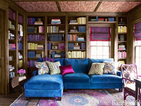 With its lush dose of ultramarine, a custom Lee Industries sectional sofa covered in Fabricut's Renaissance velvet adds vibrancy to a traditional library. For more zing, Harper painted the client's desk chair in Benjamin Moore's Mulberry. Oriental rug, Stark. Pheasant wallpaper on the ceiling, Twigs.