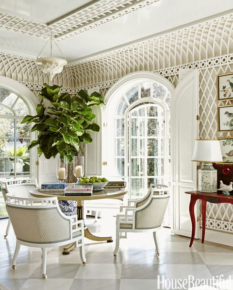 Placed near the doors to the garden, a John Rosselli table and DeAngelis chairs in Veere Grenney's Temple upholstery provide a breezy setting for lunch. At night, a Moroccan-style light fixture throws sparkle onto the ceiling.