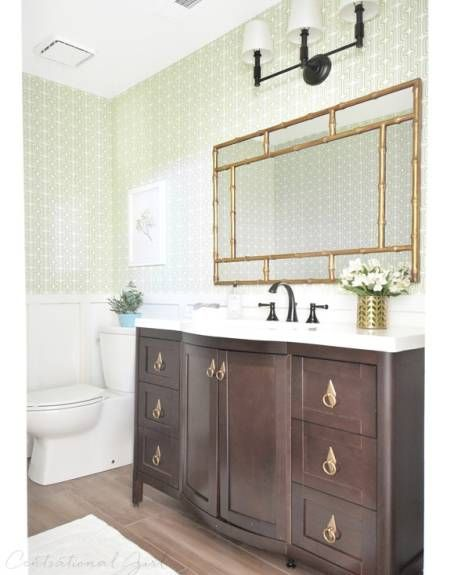 "After a <a target=""_blank"" href=""http://www.housebeautiful.com/room-decorating/bathrooms/a3315/bathroom-makeover-centsational-girl/"">top-to-bottom overhaul</a>, the new bathroom features sophisticated details like a new vanity, white board and batten, and a faux-bamboo chinoiserie mirror."