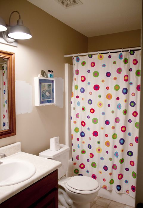 "A cartoonish shower curtain and a child-sized toilet made this bland bathroom inappropriate for the adult members of <a target=""_blank"" href=""http://www.hometalk.com/4154434/guest-friendly-nautical-style-small-bath-makeover"">blogger Southern Revivals</a>'s family."