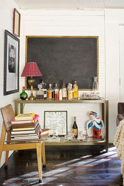 Room, Bottle, Interior design, Glass bottle, Drink, Picture frame, Interior design, Paint, Drinkware, Distilled beverage,