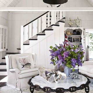 Room, Interior design, Wall, Living room, Home, Floor, Furniture, White, Ceiling, Purple,