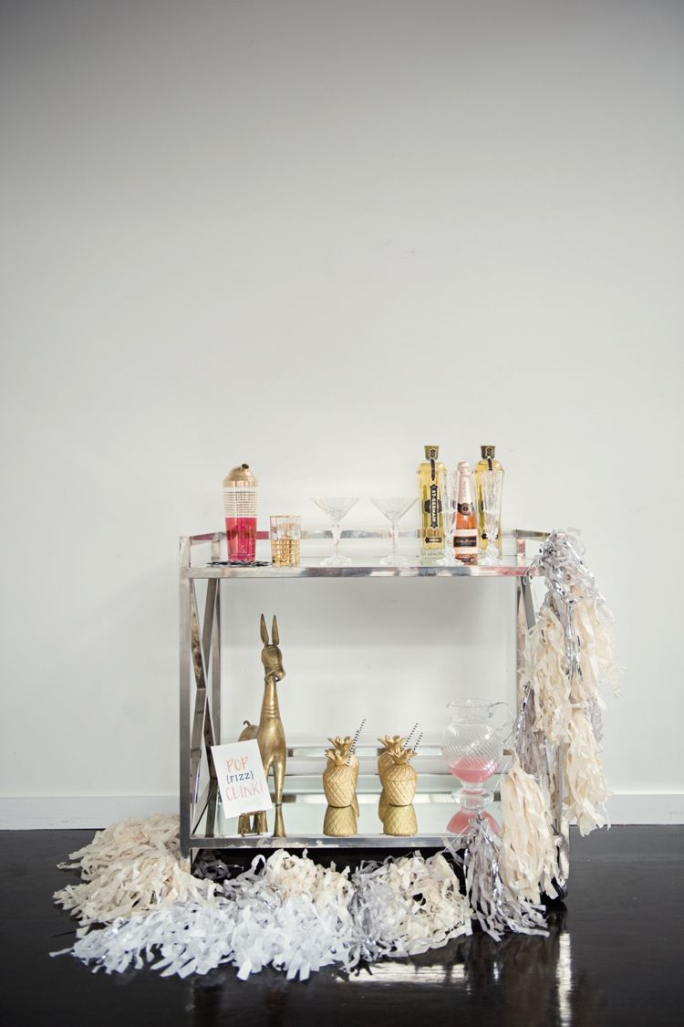 "Instead of having guests crowd around one table for food and drinks, create a separate zone just for mixing cocktails. Bonus points if it's as chic as this one from <a target=""_blank"" href=""http://eventjubilee.com/testsite/"">Jubilee Events</a>."