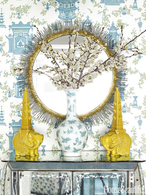 A vase from Bungalow 5 and a pair of elephant &lt;em&gt;tulipieres &lt;/em&gt;pick up the colors of the entry's Follies wallpaper by Tyler Hall.   &lt;em&gt;Clarendon mirror, Crate &amp;amp; Barrel.&lt;/em&gt;   <!--EndFragment-->