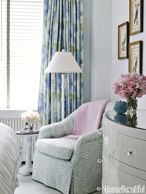 <!--StartFragment-->The shapely curve of the Natalie dresser by Worlds Away and a chair covered in Charlotte Moss's Fanny are inviting. Curtains in Hampton Ponds by Thibaut match the headboard.   <em>Albero table by Bunny Williams Home.</em>