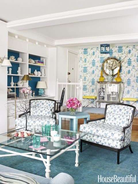 Bold aqua and freewheeling patterns bring cheer to a one-bedroom Manhattan apartment. The Nonchalant lounge chairs by Barbara Barry for McGuire are covered in Lulu DK's Dancers. 