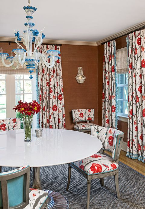 "<p><strong>Why we love it:</strong> The splashy floral fabrics bring energy to the formal space.</p><p><strong>Behind the design:</strong> Pyne made sure to include the glass chandelier, which was purchased by the homeowners on a vacation in Venice, in the final design. ""Seeing something you love every day makes you happy,"" Pyne says.</p>"