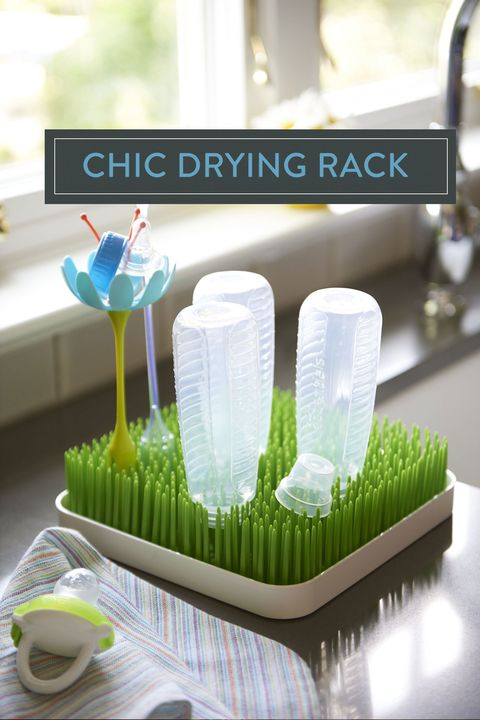 "<p>With an infant in the house, dedicated work zones are especially crucial. Flank a lawn-themed bottle-drying rack next to the sink for both function and fun pop of color. </p><p><em>Boon grass bottle rack, <a href=""http://www.booninc.com/products/Grass/373"" target=""_blank"">booninc.com</a>; Munchkin pacifier, <a href=""http://www.munchkin.com/latchtm-pacifier-0-mo-2-pack-green-orange.html?___SID=U"" target=""_blank"">munchkin.com</a></em><br></p>"