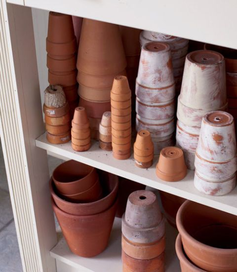 <p>Once clean, turn your terra-cotta pots upside down to prevent them from filling with water, freezing, and cracking. Stack them to save on space.</p>