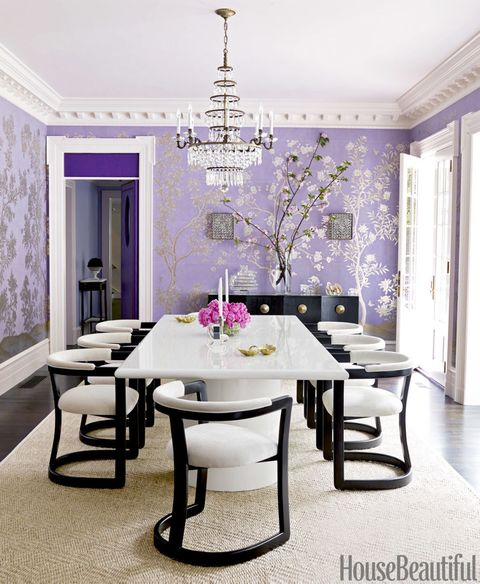 "For the dining room of this <a href=""http://www.housebeautiful.com/design-inspiration/house-tours/g2219/purple-house-design/"">Massachusetts house</a>, Mary McGee designed a bold lacquered table and contemporary chairs that contrast with the delicate hand-painted Chinese wallpaper by Gracie. Door and transom upholstered in an Edelman leather. Room trim in Benjamin Moore's Ivory White."
