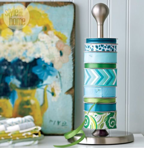 """<p>Instead of letting your pretty ribbon collection get tangled up in a box, put it on display. When you need a piece, pull on the end of the color or pattern you want to dispense.</p><p><em><a href=""""http://www.styleathome.com/how-to/simple-projects/diy-project-ribbon-holder/a/54906?utm_source=newsletter&utm_medium=email&utm_campaign=sah_dd_140423&cuid=172213c784b271ee1a1329309123b156"""" target=""""_blank"""">See more at Style at Home »</a></em></p>"""