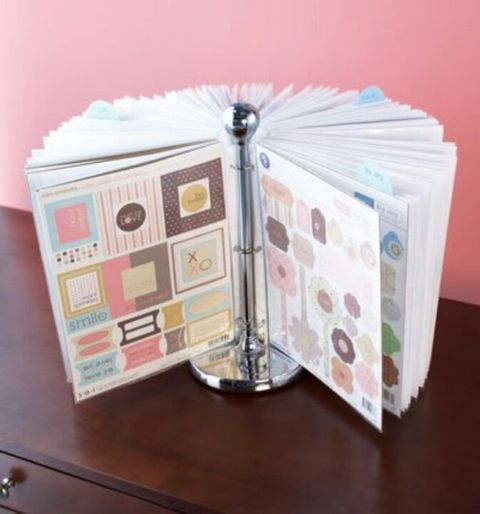 """<p>This is about to change avid scrapbookers' lives: Clasp binder clips with page protectors filled with stickers on the rod of a paper towel holder. It's a spinning solution that prevents digging through all of your favorite supplies.</p><p><em><a href=""""http://www.clubcreatingkeepsakes.com/blogs/ck_community/archive/2010/04/26/5-easy-ideas-for-storing-your-stickers.aspx"""" target=""""_blank"""">See more at Club Creating Keepsakes »</a></em><a href=""""http://www.clubcreatingkeepsakes.com/blogs/ck_community/archive/2010/04/26/5-easy-ideas-for-storing-your-stickers.aspx"""" target=""""_blank""""></a></p>"""