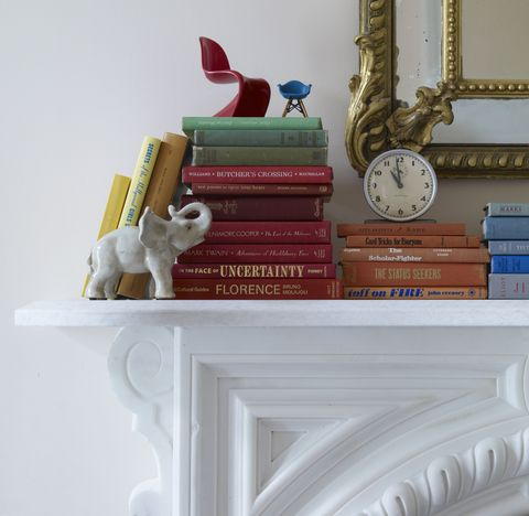 <p>A fully-stocked bookcase makes any room instantly cozier, but your library shouldn't be confined to tightly packed shelves. Stacking volumes on a mantel brings a lived-in vibrancy to your home — and may just inspire a bit of fireside reading.</p>