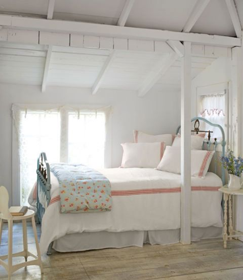 "<p>The mostly white bedding in this <a target=""_blank"" href=""http://www.countryliving.com/home-design/house-tours/g111/fifi-oneill-florida-tiny-home/?slide=7"">Florida cottage</a> creates a cohesive (rather than choppy) look. A few red stripes and the floral coverlet add just enough pattern to bring some life to the room.</p>"