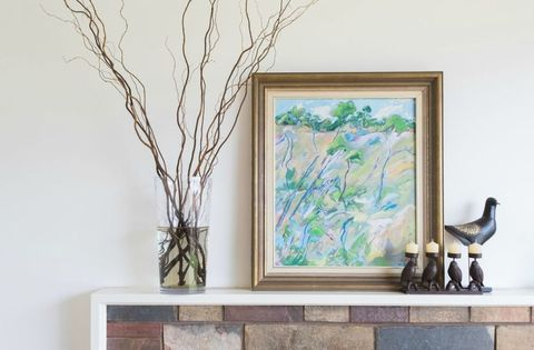 <p>Use your mantel as a ledge to prop up your favorite colorful painting — it's a fresher, yet more casual, look than hanging it. </p>