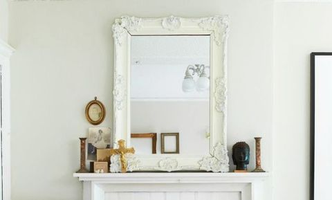 <p>Mirrors make any room seem more expansive, so place one above a fireplace for a bit of optical magic. Pick a mirror with a simple frame to prevent your mantel from looking overcrowded.</p>