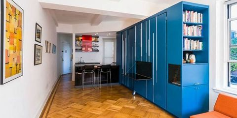 There's an Entire Apartment Hiding in This Big Blue Cabinet