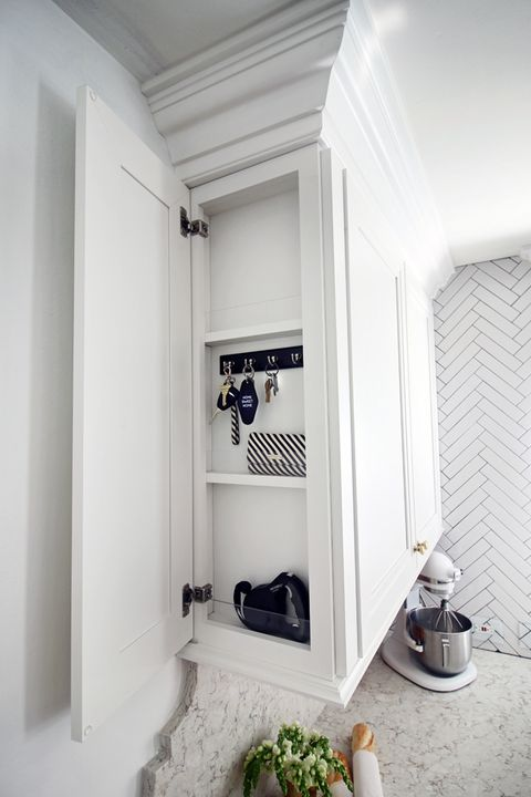 "<p>This narrow cupboard makes use of the bare side of a cabinet — genius! — an ensures that keys always have a tidy home to return to each evening. </p><p><a href=""http://www.huntedinterior.com/2015/04/kitchen-reveal-with-martha-stewart.html#more"" target=""_blank""><em>See more at Hunted Interior »</em></a> </p>"