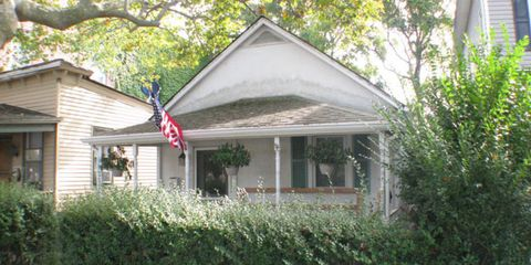 Property, House, Roof, Real estate, Home, Building, Shrub, Land lot, Flag, Fixture,