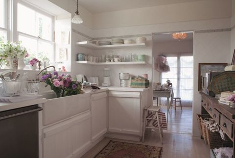 "<p>Her self-described ""hodgepodge"" style (a little bit Spanish, southern, English, and country) lends itself to layering new treasures with time-worn beauties. In Ashwell's kitchen, open shelving allows her to show off her collection of eclectic dishes. <span></span></p>"
