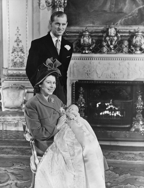 15th December 1948: Princess Elizabeth and The Prince Philip, Duke of Edinburgh with Prince Charles after his christening at Buckingham Palace.