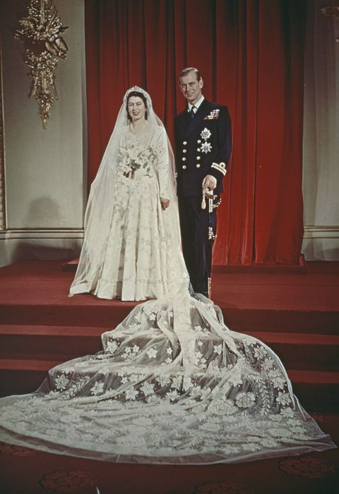 Princess Elizabeth and Prince Philip, Duke of Edinburgh pose together at Buckingham Palace after their wedding ceremony at Westminster Abbey in London on 20th November 1947. Elizabeth wears a wedding gown designed by Norman Hartnell.