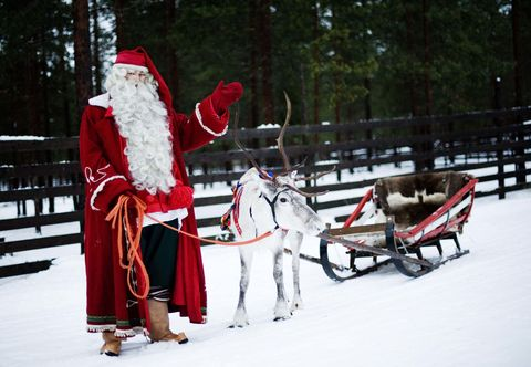Winter, Snow, Hat, Holiday, Costume accessory, Carmine, Santa claus, Carriage, Costume hat, Fictional character,