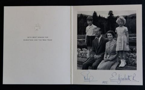 A photograph from a Christmas card dated 1955 showing Queen Elizabeth II and the Duke of Edinburgh alongside children Prince Charles and Princess Anne.