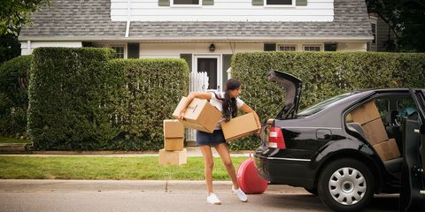 Woman moving boxes into car