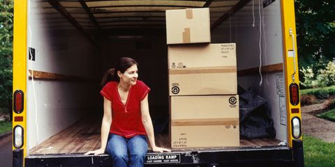 Woman in a moving truck with boxes