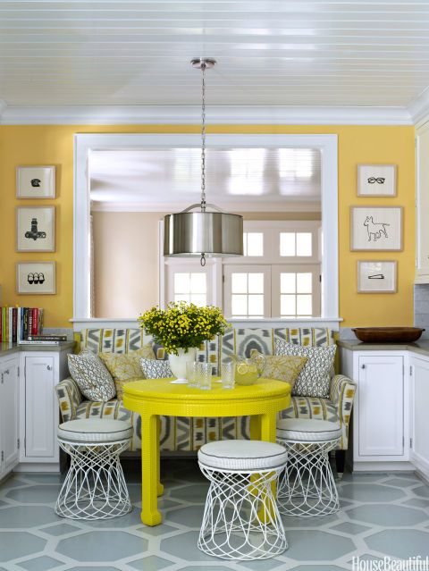 Drum shaped lamp shade in yellow themed room