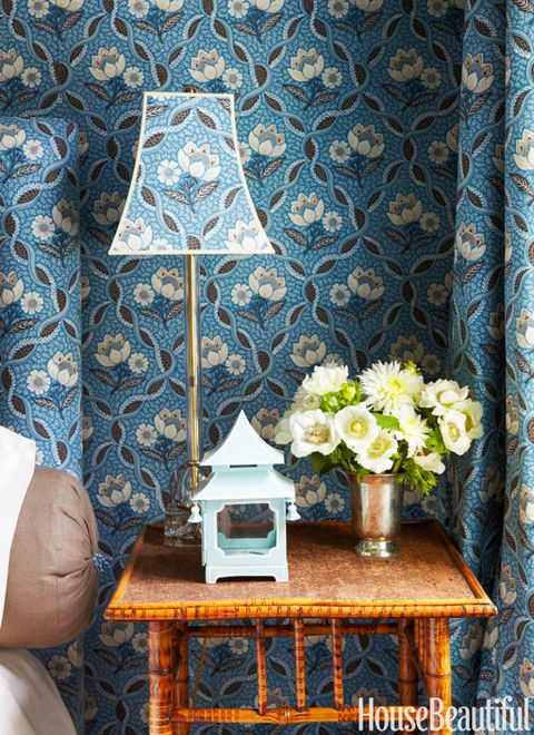 Blue bell shaped lamp on end table