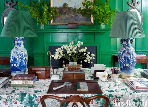 """""""There's a sense of order and calm that comes from symmetry,"""" says Redd. The table lamps were purchased at auction. Shades from Gracious Home."""