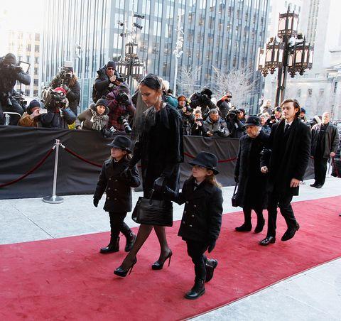 Footwear, Winter, Carpet, Pedestrian, Boot, Fur, Overcoat, Leather,