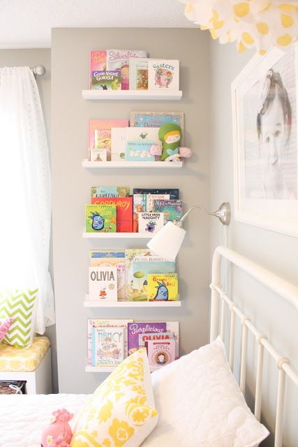 kids book storage on wall