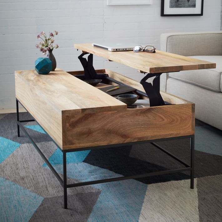 "<p>A lift-up tabletop not only adds extra space underneath, but can also double as a (stylish) TV tray table. </p><p><em>$600, </em><a href=""http://www.westelm.com/products/rustic-storage-coffee-table-g569/"" target=""_blank""><em>West Elm</em></a></p>"
