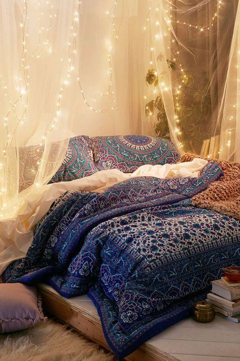 Blue, Interior design, Room, Textile, Interior design, Window treatment, Purple, Bedroom, Linens, Bedding,