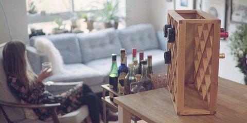 Wood, Bottle, Hardwood, Glass bottle, Furniture, Drink, Drinkware, Couch, Living room, Wine bottle,